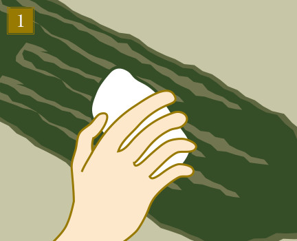 ①固く絞った濡れ布巾で昆布の表面をさっと拭く
